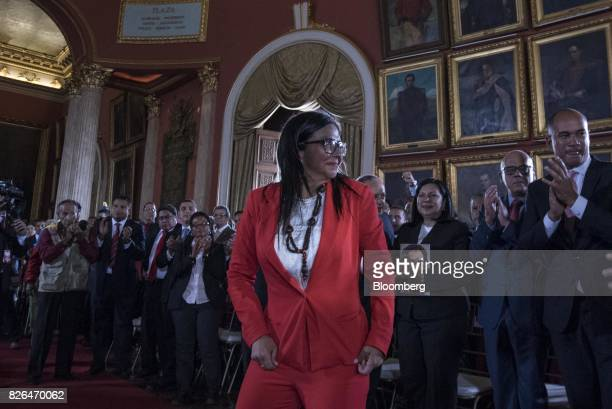 Delcy Rodriguez center walks to the podium to accept her new post as President of the Constituent Assembly in Caracas Venezuela on Friday Aug 4 2017...