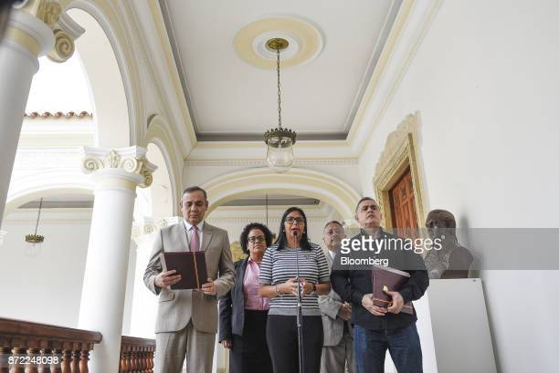 Delcy Rodriguez president of the Constituent Assembly center speaks while Maikel Moreno president of the Supreme Court of Venezuela left and...