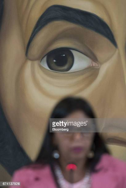 Delcy Rodriguez Venezuela's minister of foreign affairs speaks as the painted eye of Venezuelan political leader of Simon Bolivar is seen during a...