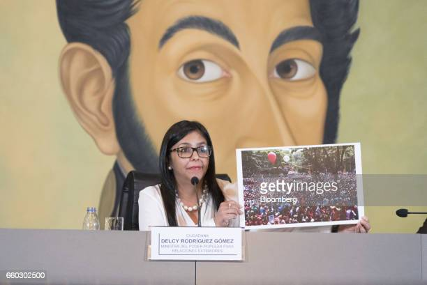 Delcy Rodriguez Venezuela's minister of foreign affairs speaks while holding up a photograph of a protest to reject the Organization For American...