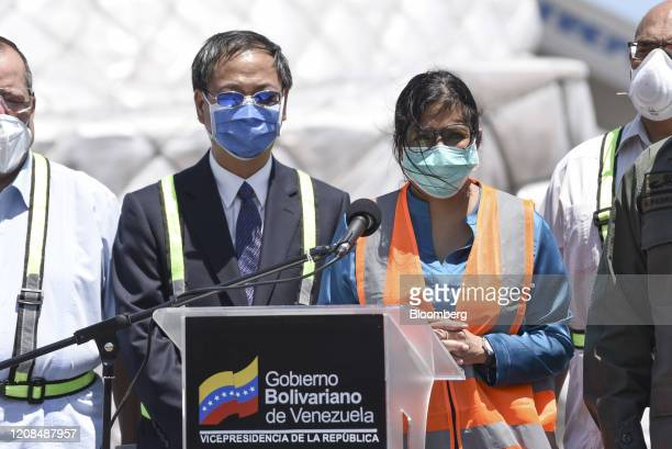 Delcy Rodriguez, Venezuela's vice president, right, and Li Baorong, China's ambassador to Venezuela, prepare to speak at a news conference in front...