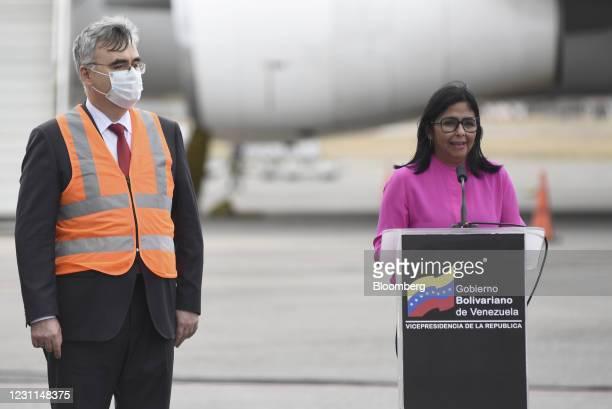 Delcy Rodriguez, Venezuela's vice president, right, speaks as Sergey Melik-Bagdasarov, Russia's ambassador to Venezuela, listens during a press...