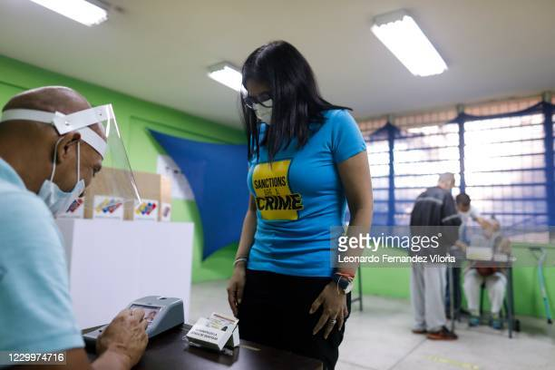 Delcy Rodriguez Vice President of the Bolivarian Republic of Venezuela waits in front of the fingerprint machine at the Padre Mendoza School voting...