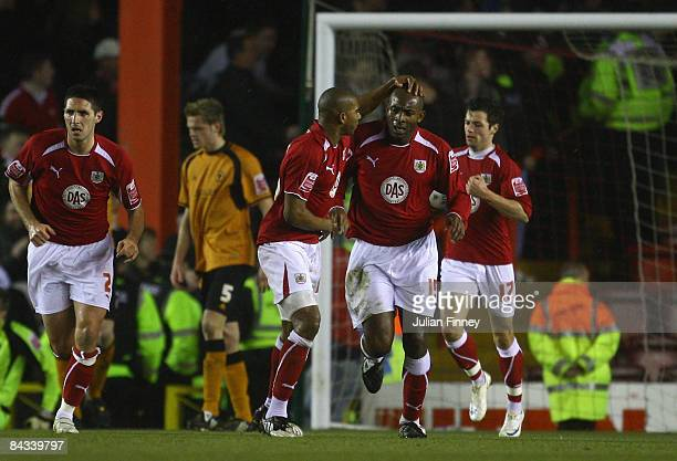 Dele Adebola of Bristol City is congratulated after scoring a goal during the CocaCola Championship match between Bristol City and Wolverhampton...