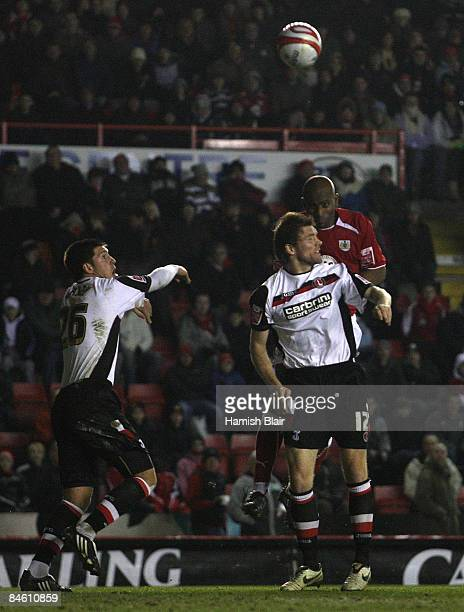 Dele Adebola of Bristol scores his and Briistol's first goal over Darren Ward of Charlton during the CocaCola Championship match between Bristol City...