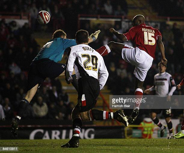 Dele Adebola of Bristol scores his and Bristol's second goal over Robert Elliot goalkeeper for Charlton during the CocaCola Championship match...