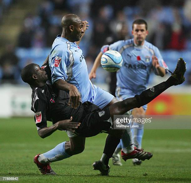Dele Adebola of Coventry and Leon Barnett of West Bromwich Albion challenge for the ball during the CocaCola Championship match between Coventry City...