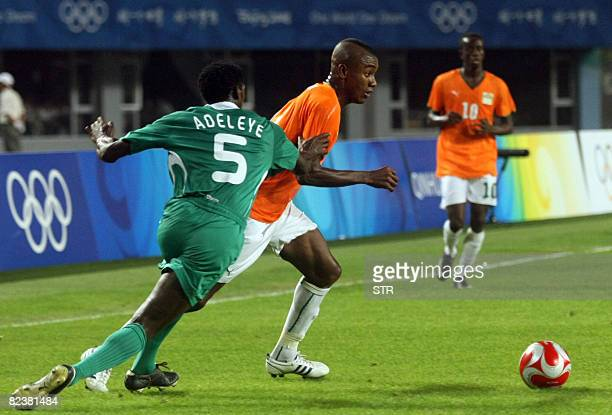 Dele Adeleye of Nigeria vies with a player of Ivory Coast during the 2008 Beijing Olympic Games men's quarterfinals football match at the...
