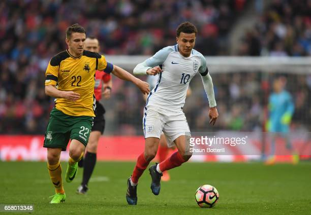 Dele Ali of England holds off Fiodor Cernych of Lithuania during the FIFA 2018 World Cup Qualifier between England and Lithuania at Wembley Stadium...