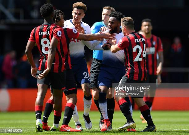 Dele Alli and Danny Rose of Tottenham Hotspur clash with Jefferson Lerma of Bournemouth and Ryan Fraser of Bournemouth during the Premier League...