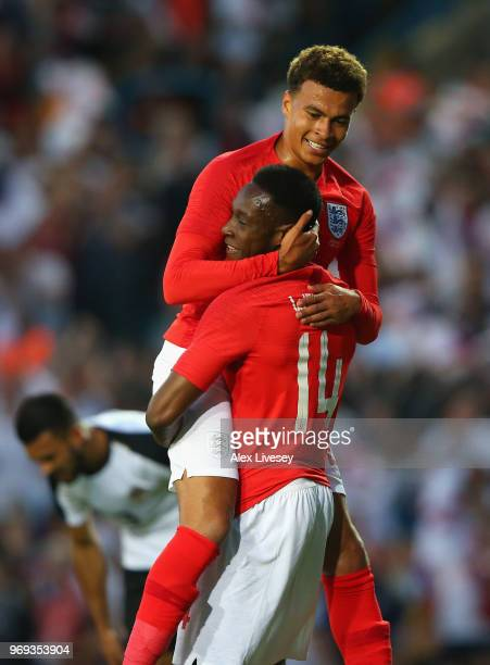 Dele Alli and Danny Welbeck of England celebrate after Danny Welbeck scored their sides second goal during the International friendly match between...