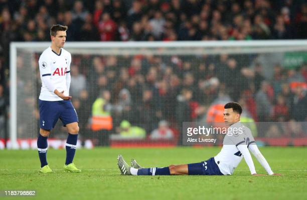 Dele Alli and Giovani Lo Celso of Tottenham Hotspur react in defeat after the Premier League match between Liverpool FC and Tottenham Hotspur at...