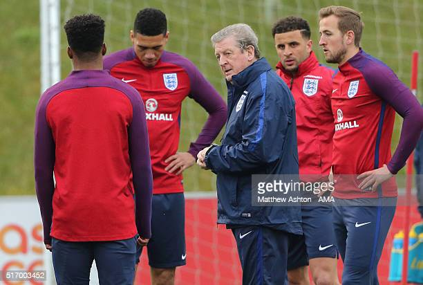 Dele Alli and Harry Kane of England look on as manager Roy Hodgson talks to his players during the England training session at St Georges Park on...