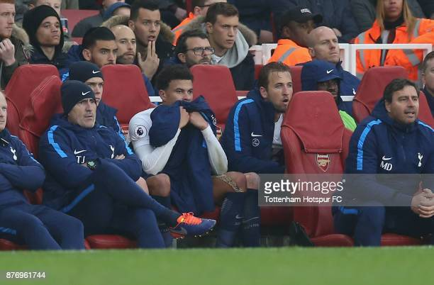 Dele Alli and Harry Kane of Tottenham sit on the bench after being substituted during the Premier League match between Arsenal and Tottenham Hotspur...