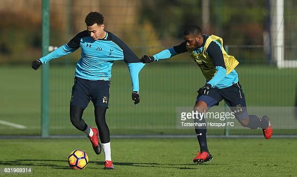 Dele Alli and Japhet Tanganga of Tottenham during the Tottenham Hotspur training session at Tottenham Hotspur Training Centre on January 18 2017 in...