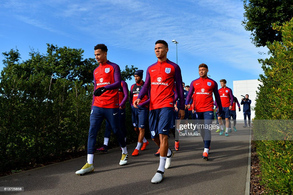 Dele Alli (L) and Kieran Gibbs walk out for an England training session at the Tottenham Hotspur training ground on October 10, 2016 in Enfield, England.