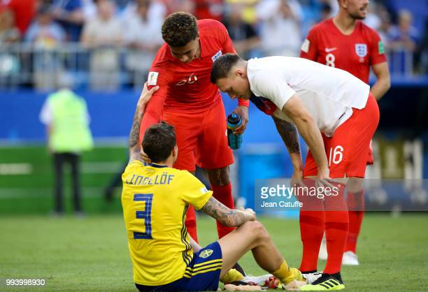 Dele Alli and Phil Jones of England console Victor Lindelof of Sweden following the 2018 FIFA World Cup Russia Quarter Final match between Sweden and...