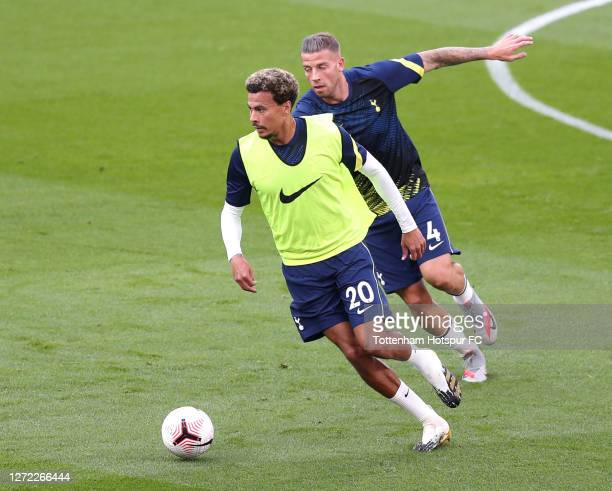 Dele Alli and Toby Alderweireld of Tottenham Hotspur warm up prior to the Premier League match between Tottenham Hotspur and Everton at Tottenham...