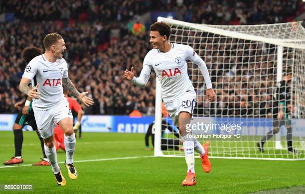 Dele Alli celebrates scoring his side's first goal with Kieran Trippier of Tottenham Hotspur during the UEFA Champions League group H match between...