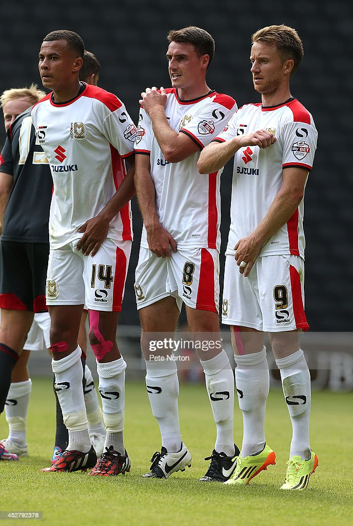 Dele Alli, Darren Potter and Dean Bowditch of MK Dons line up to defend a free kick during the Pre-Season Friendly match between MK Dons and Nottingham Forest at Stadium mk on July 27, 2014 in Milton Keynes, England.