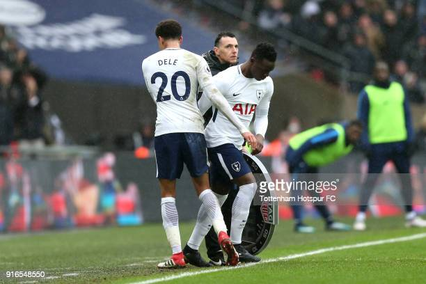 Dele Alli is substituted for Victor Wanyama of Tottenham Hotspur during the Premier League match between Tottenham Hotspur and Arsenal at Wembley...