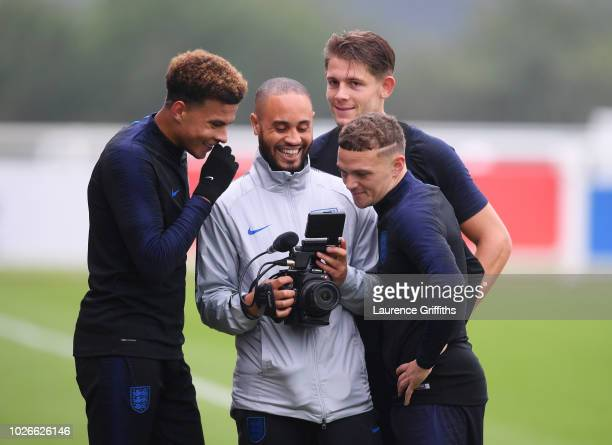 Dele Alli James Tarkowski and Kieran Trippier of England look at a video camera during an England training session at St Georges Park on September 4...