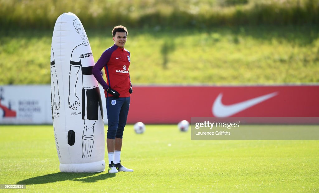 Dele Alli looks on during a training session as part of England media access at St George's Park on June 6, 2017 in Burton-upon-Trent, England.