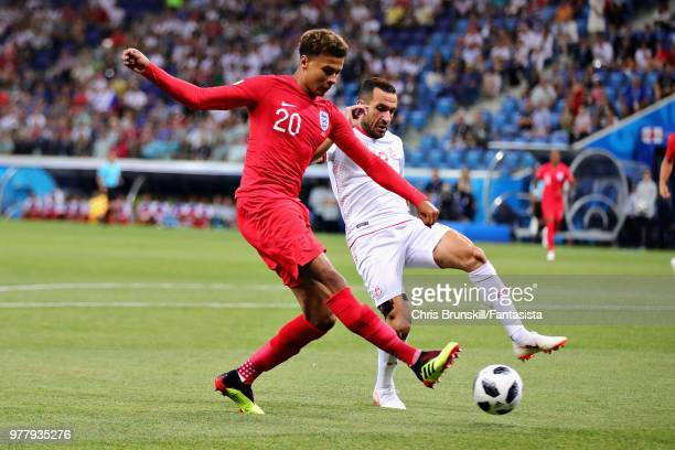 Dele Alli of England and Ali Maaloul of Tunisia in action during the 2018 FIFA World Cup Russia group G match between Tunisia and England at...
