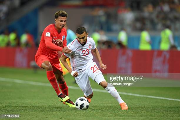 Dele Alli of England and Naim Sliti of Tunisia battle for the ball during the 2018 FIFA World Cup Russia group G match between Tunisia and England at...