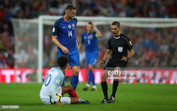 Dele Alli of England appeals to referee Clement Turpin during the FIFA 2018 World Cup Qualifier between England and Slovakia at Wembley Stadium on...