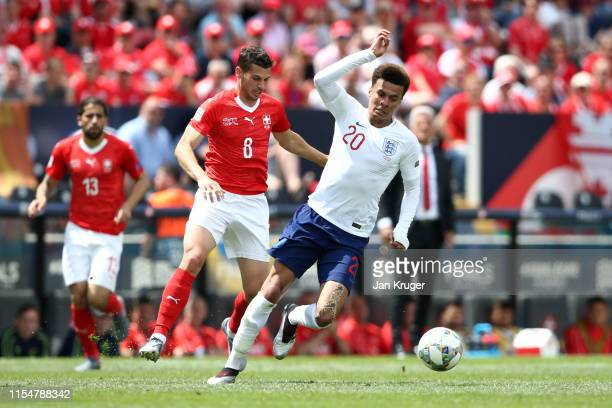 Dele Alli of England battles for possession with Remo Freuler of Switzerland during the UEFA Nations League Third Place Playoff match between...