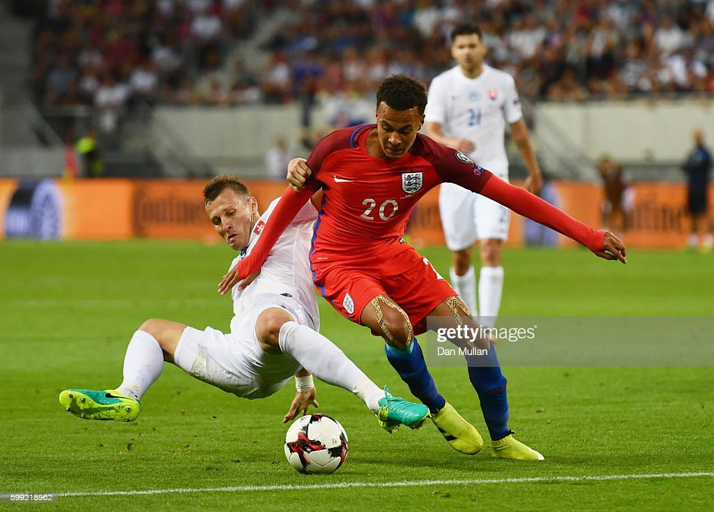 Dele Alli of England battles with Jan Durica of Slovakia during the 2018 FIFA World Cup Group F qualifying match between Slovakia and England at City Arena on September 4, 2016 in Trnava, Slovakia.