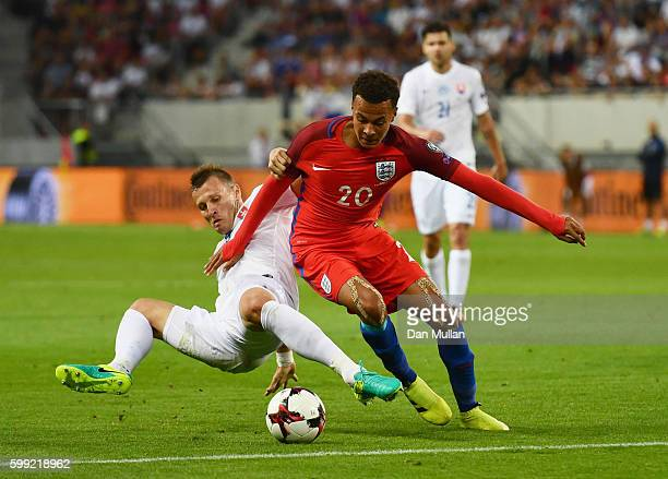 Dele Alli of England battles with Jan Durica of Slovakia during the 2018 FIFA World Cup Group F qualifying match between Slovakia and England at City...