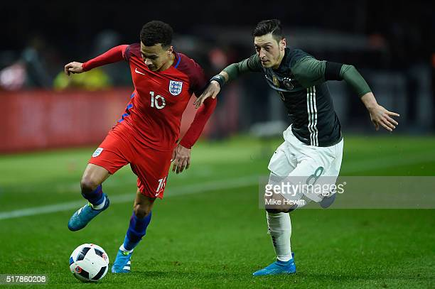 Dele Alli of England battles with Mesut Ozil of Germany during an International friendly between Germany and England at Olympiastadion on March 26...