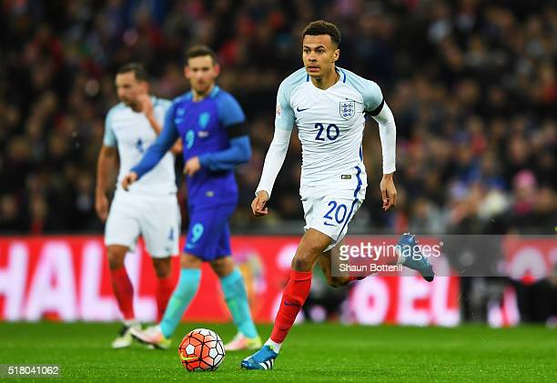 Dele Alli of England breaks with the ball during the International Friendly match between England and Netherlands at Wembley Stadium on March 29 2016...