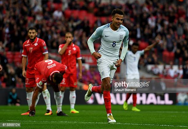Dele Alli of England celebrates after scoring his teams second goal of the game during the FIFA 2018 World Cup Qualifier Group F match between...