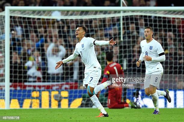 Dele Alli of England celebrates scores his team's first goal during the International Friendly match between England and France at Wembley Stadium on...