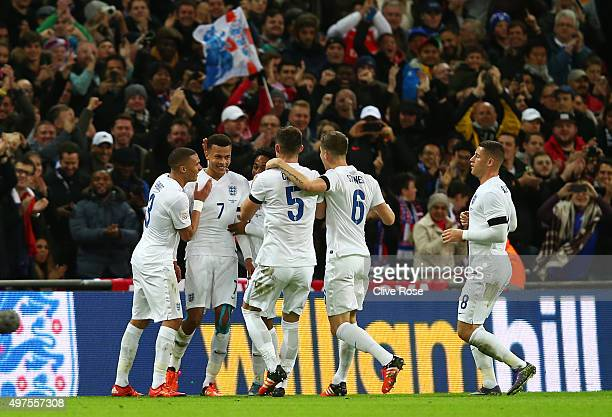 Dele Alli of England celebrates scoring his team's first goal with his team mates during the International Friendly match between England and France...