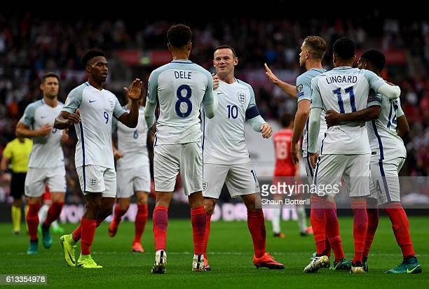 Dele Alli of England celebrates with team mates after scoring his teams second goal of the game during the FIFA 2018 World Cup Qualifier Group F...