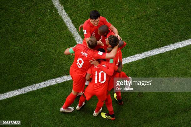 Dele Alli of England celebrates with teammates after scoring his team's second goal during the 2018 FIFA World Cup Russia Quarter Final match between...