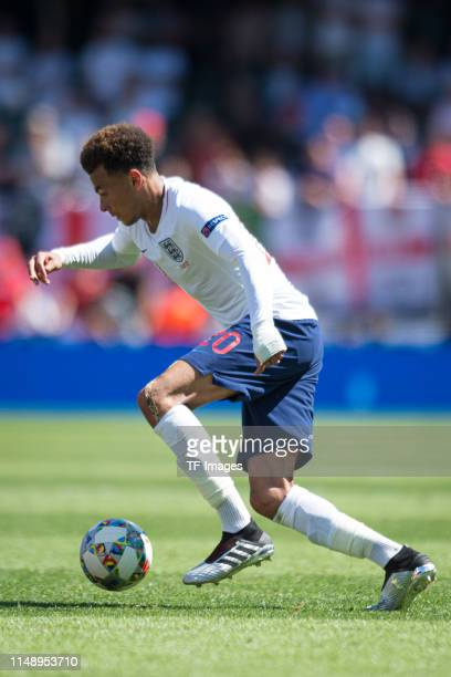 Dele Alli of England controls the ball during the UEFA Nations League Third Place Playoff match between Switzerland and England at Estadio D Afonso...