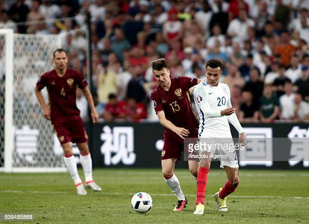 Dele Alli of England in action against Aleksandr Golovin of Russia during Euro 2016 group B football match between England and Russia at Stade...