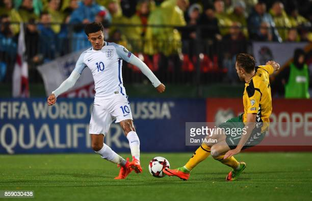 Dele Alli of England is challenged by Arturas Zulpa of Lithuania during the FIFA 2018 World Cup Group F Qualifier between Lithuania and England at...