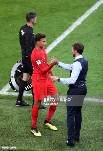 Dele Alli of England is congratulated by Gareth Southgate Manager of England after being replaced during the 2018 FIFA World Cup Russia Round of 16...