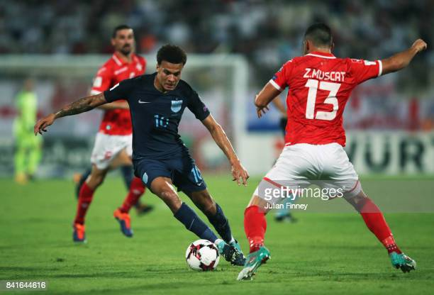 Dele Alli of England is faced by Zach Muscat of Malta during the FIFA 2018 World Cup Qualifier between Malta and England at Ta'Qali National Stadium...