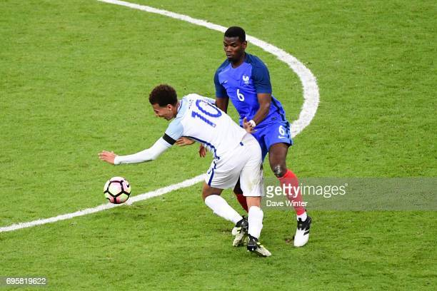 Dele Alli of England is fouled by Paul Pogba of France during the International friendly match between France and England at Stade de France on June...