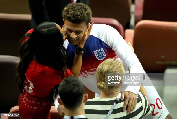 Dele Alli of England is kissed by girlfriend Ruby Mae following the 2018 FIFA World Cup Russia Semi Final match between England and Croatia at...