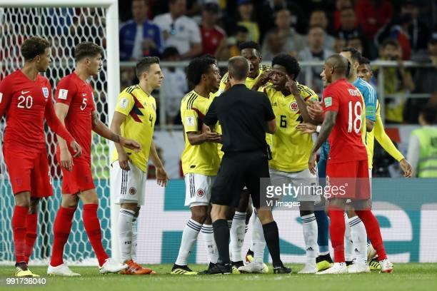Dele Alli of England John Stones of England Santiago Arias of Colombia Juan Cuadrado of Colombia referee Mark Geiger Jefferson Lerma of Colombia...