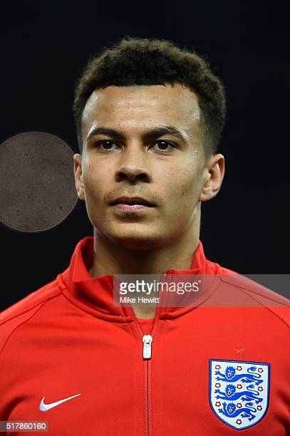 Dele Alli of England lines up for the anthems ahead of an International friendly between Germany and England at Olympiastadion on March 26 2016 in...