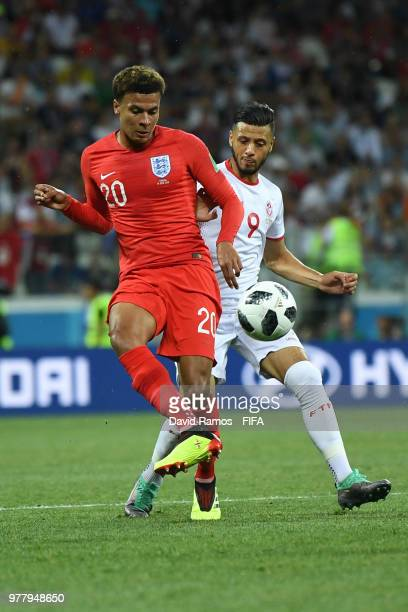 Dele Alli of England passes the ball under pressure from Anice Badri of Tunisia during the 2018 FIFA World Cup Russia group G match between Tunisia...